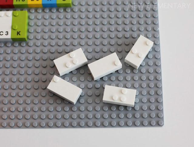 Some prototype unprinted white LEGO Braille Bricks.