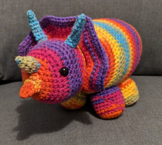 A crochet triceratops plushie with a really funny beak that looks almost like an ant eater. The head is very round compared to the previous versions.