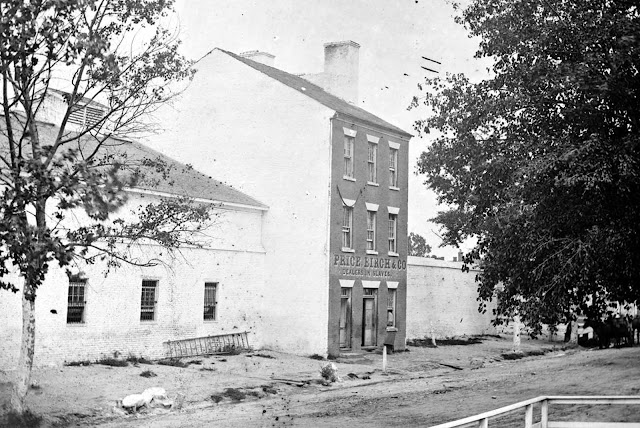 A scene in Alexandria, Virginia, in August of 1863. The storefront of 283 Duke St. reads