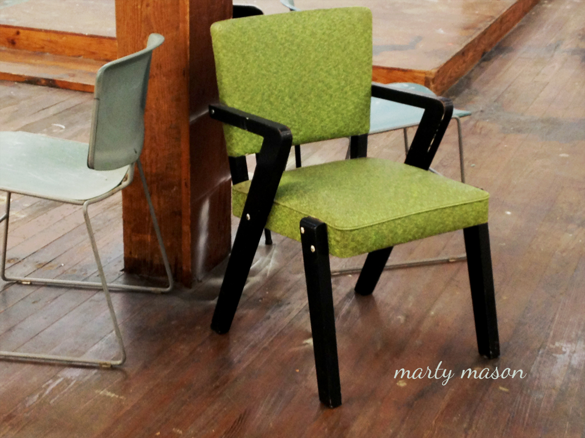 Green Chair With Only A Ceiling Support For Company   Marty Mason