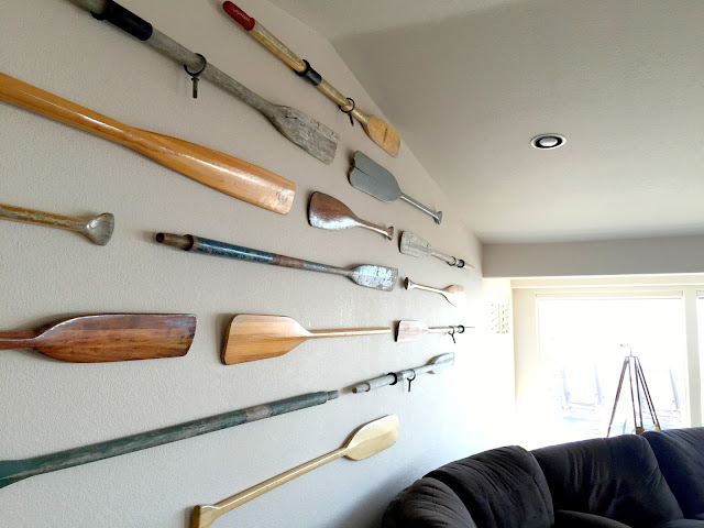 An oar gallery wall.  Perfect for a large wall in a beach home!