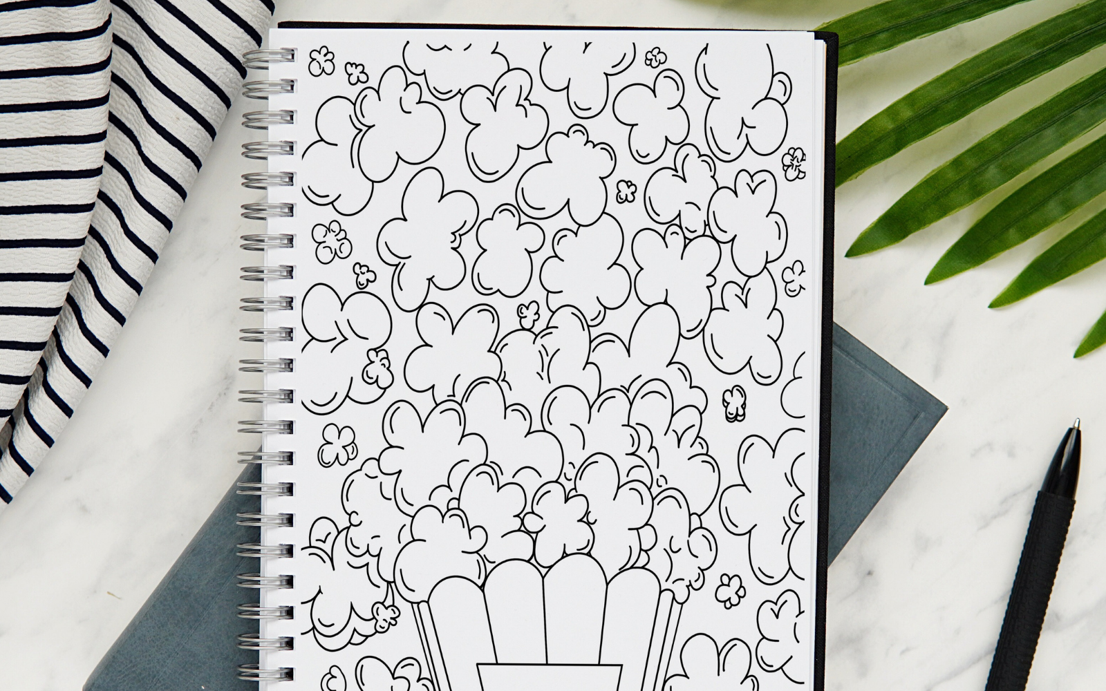 planner journal flat of the instant download of the popcorn movie tracker from my shop