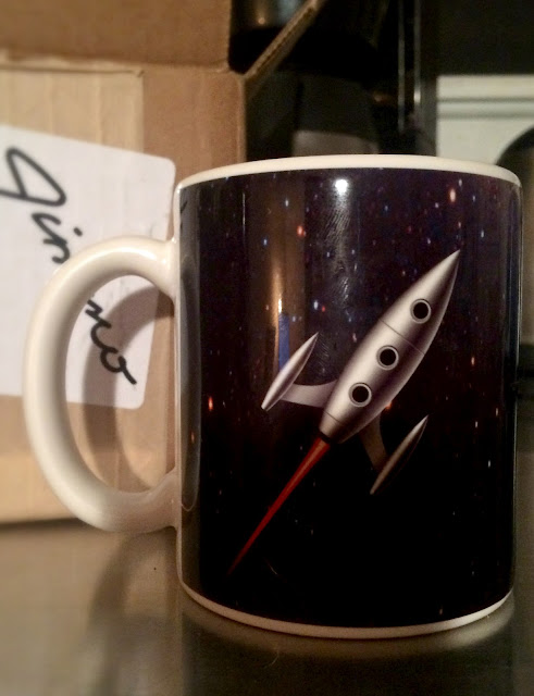 https://jimmoshirts.com/collections/mugs-by-jimmo/products/space-age-nostalgia-limited-editon-rocket-mug-by-jimmo
