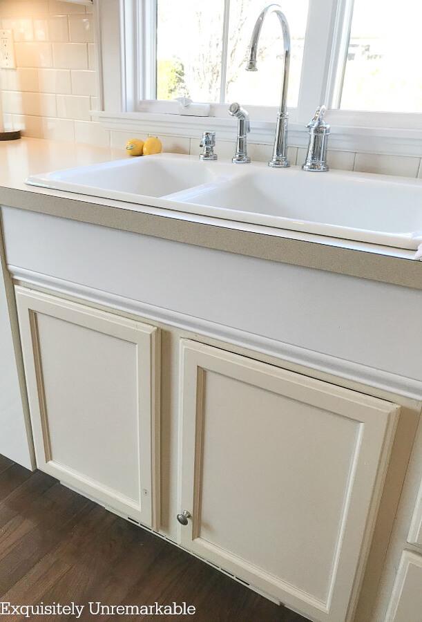 Bisque Kitchen Cabinet base under white kitchen sink