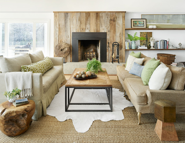 Two sofas on either side of fireplace Heather Bullard