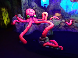 An octopus in the glow-in-the-dark section of Mr Mulligan's Lost World Adventure Golf course in Stevenage