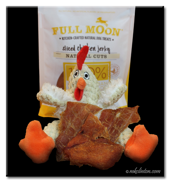 Full Moon chicken jerky bag, toy chicken and pieces of the jerky