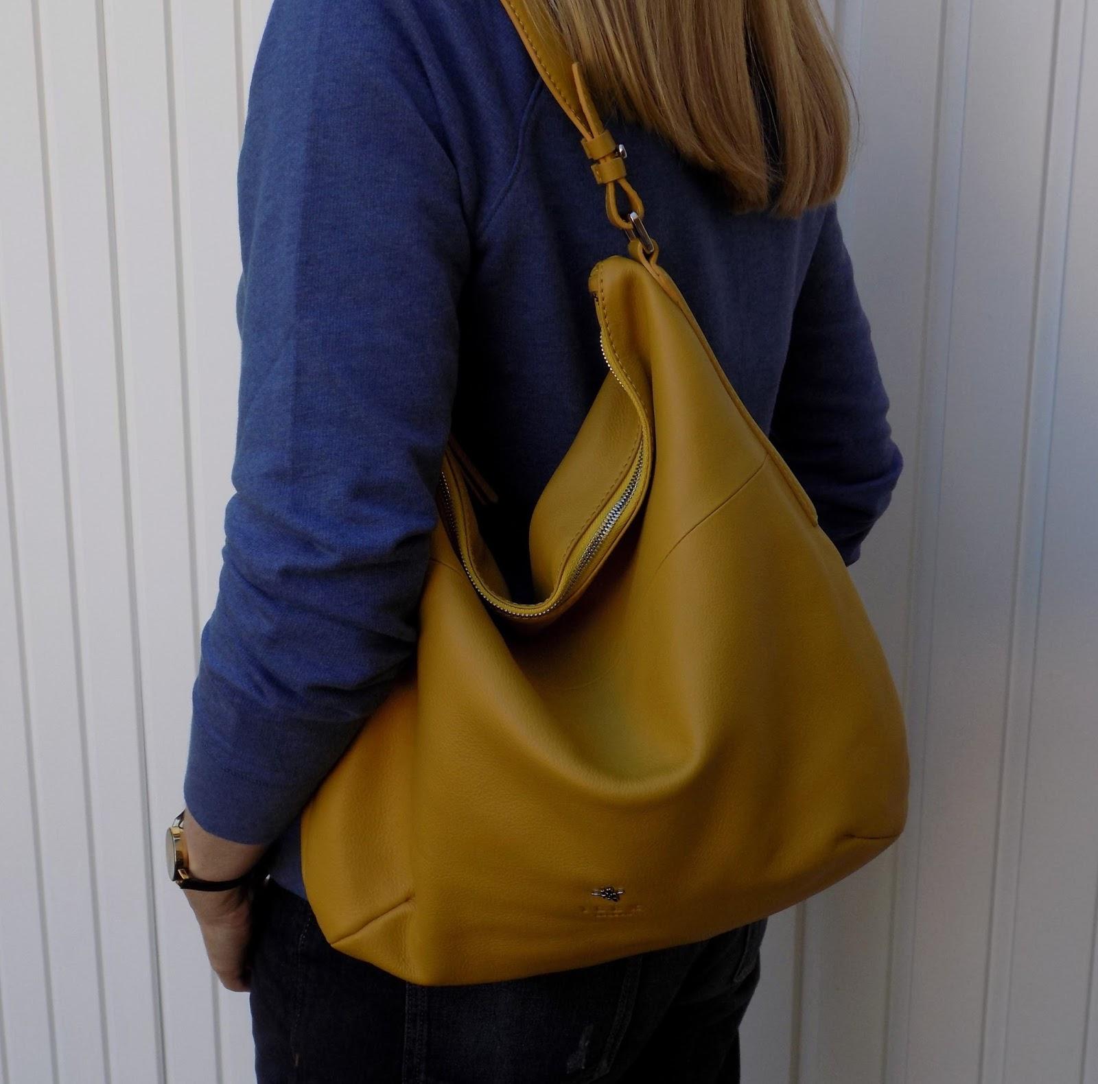 Boden slogan sweatshirt with boyfriend jeans, yellow Yull shoes and yellow handbag