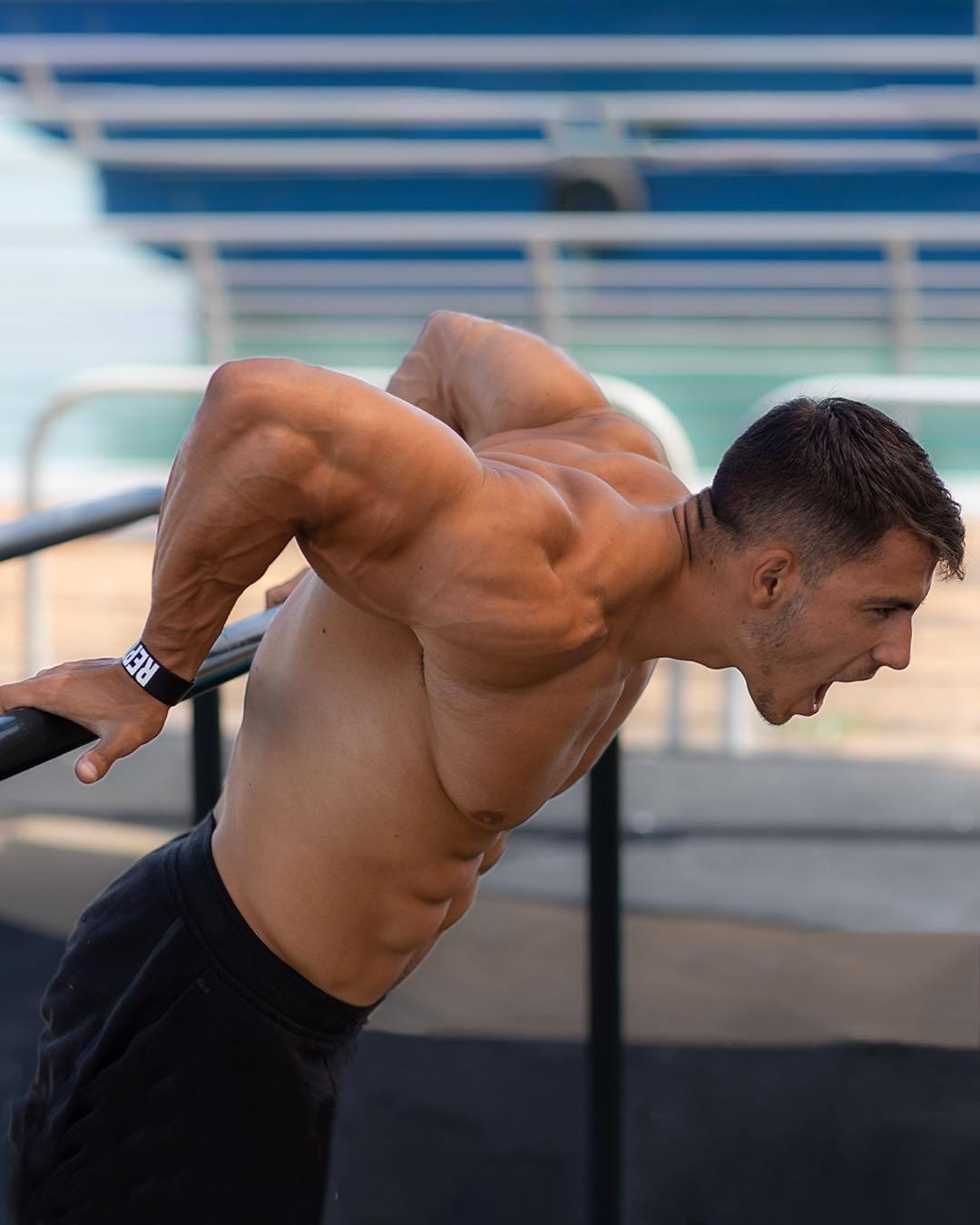 straight-masculine-young-mad-guy-outdoor-workout-biceps-huge-pecs-abs