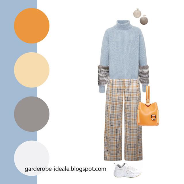 Сочетание голубого свитера и брюк в оранжевую клетку и оранжевой сумки