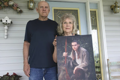 Photo of Delmar Wilson's parents holding a photo of him on a porch. Delmar Wilson was murdered in Indiana in 1994 | Momma Love True Crime