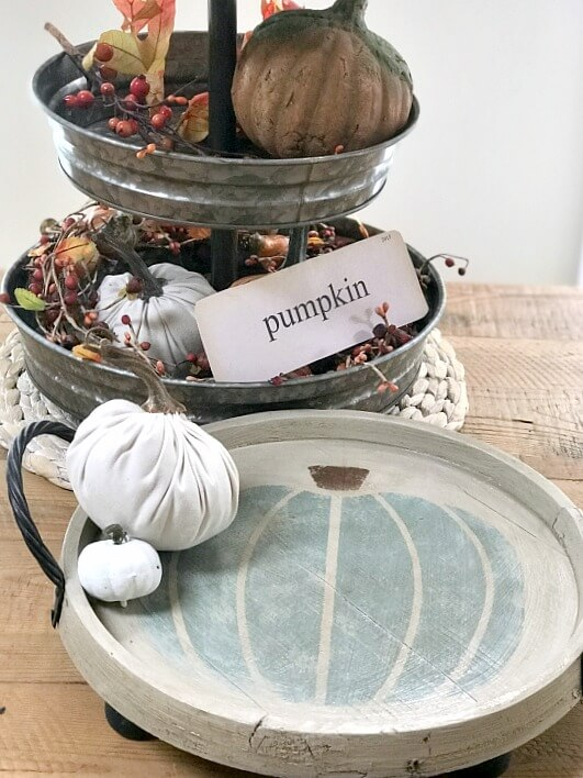 Tiered tray with fall decor and round white stenciled teal pumpkin tray
