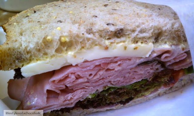 ham and brie sandwich on a white plate