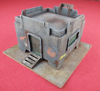 A platicraft building for the Judge Dredd miniatures game