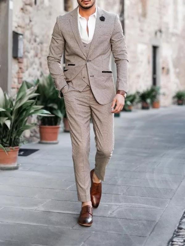Khaki colour suit with white shirts.