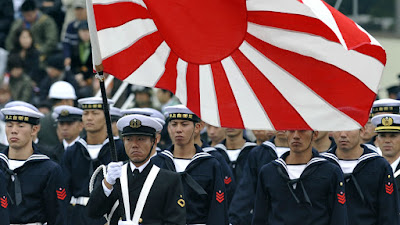 Japan sets record military budget with stealth fighters, missiles