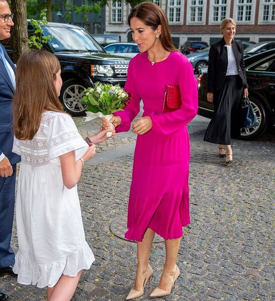 Crown Princess Mary wore No 21 long sleeve pleated midi dress, and carries Carlend Copenhagen Vanessa red clutch