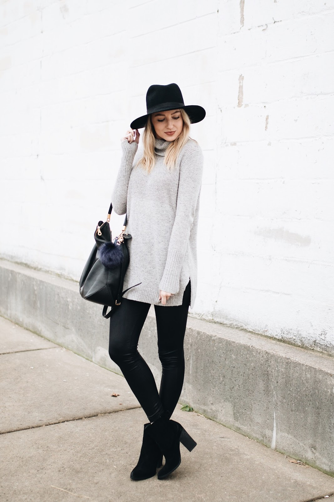 Long sweater with leather leggings
