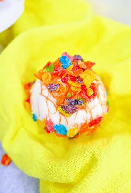 Fruity Pebbles Hot Cocoa Bombs with yellow background