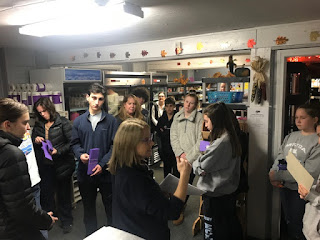 Some of this year's Food Elves gather at the Pantry for an orientation and tour