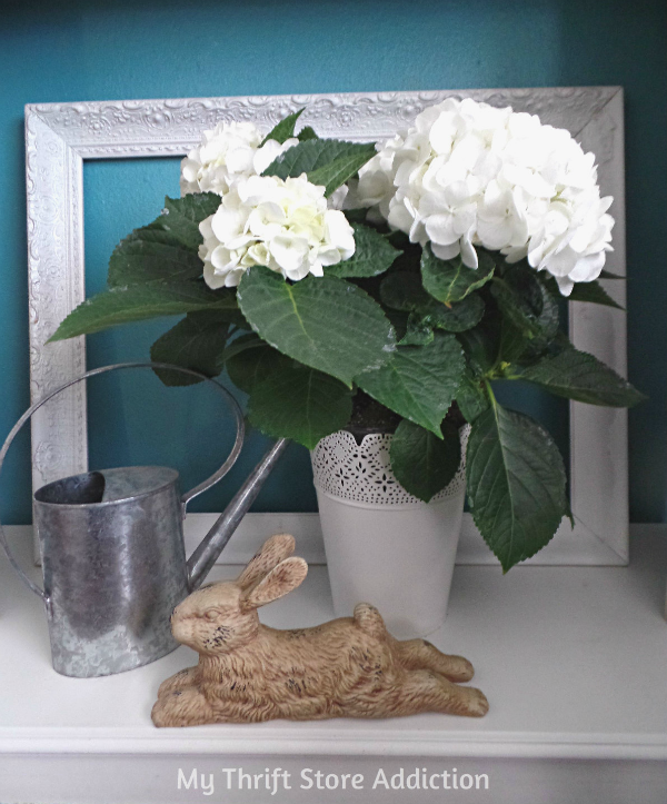 Tart Tin and Herb Flower Garden Mantel mythriftstoreaddiction.blogspot.com Fresh hydrangeas, watering can and bunny on the hearth to welcome spring!