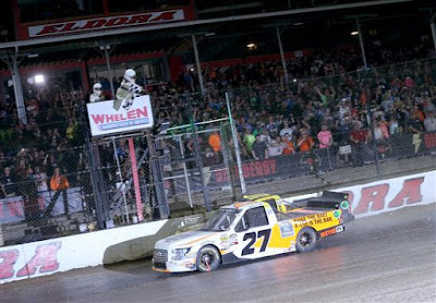 Chase Briscoe, driver of the #27 Ford Ford, takes the checkered flag to win the NASCAR Camping World Truck Series Eldora Dirt Derby at Eldora Speedway on July 18, 2018 in Rossburg, Ohio.