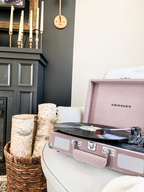 record player and wood next to fireplace