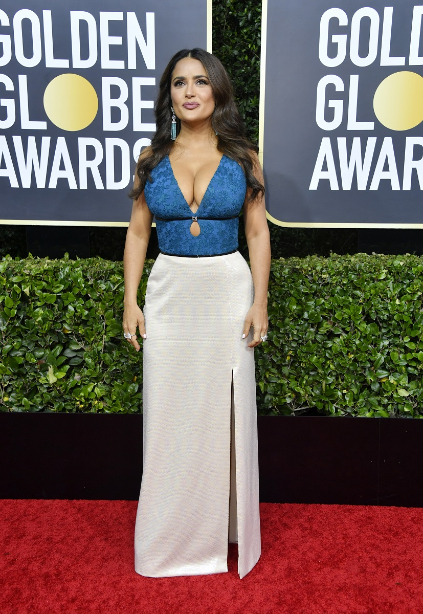 Salma Hayek looks like a bombshell in a busty blue and white Gucci design during the 77th annual Golden Globes