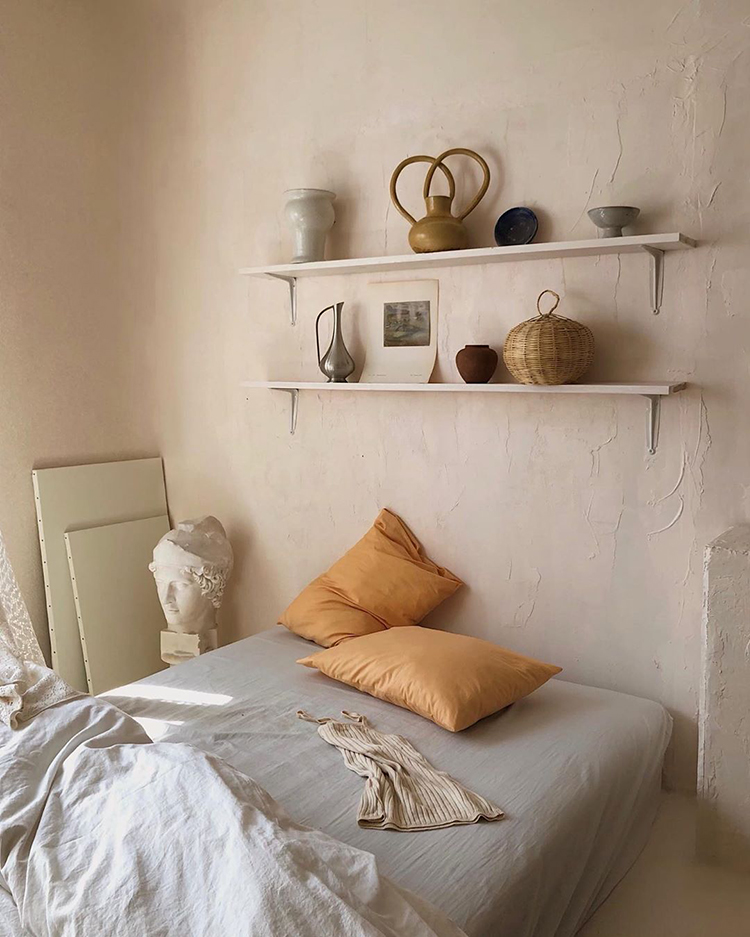 Cozy bed setting and shelves above the bed via kon_tam