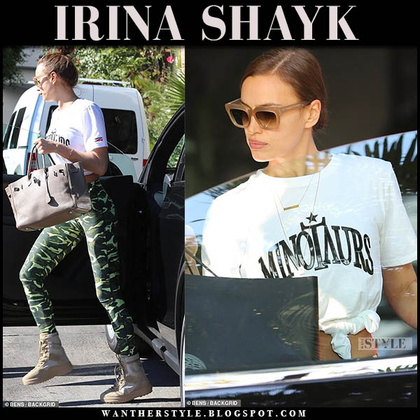 Irina Shayk in white slogan tee, green camo leggings and beige high top yeezy sneakers model off duty style january 4