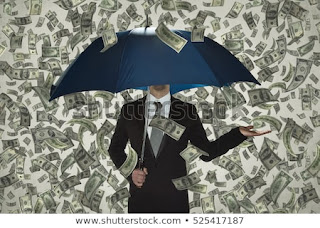 Raining money and a man holding umbrella