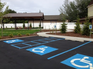 Moran UMC's parking lot with three accessible spaces and walkway.
