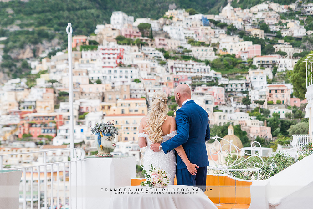 Bride and groom looking at Positano view