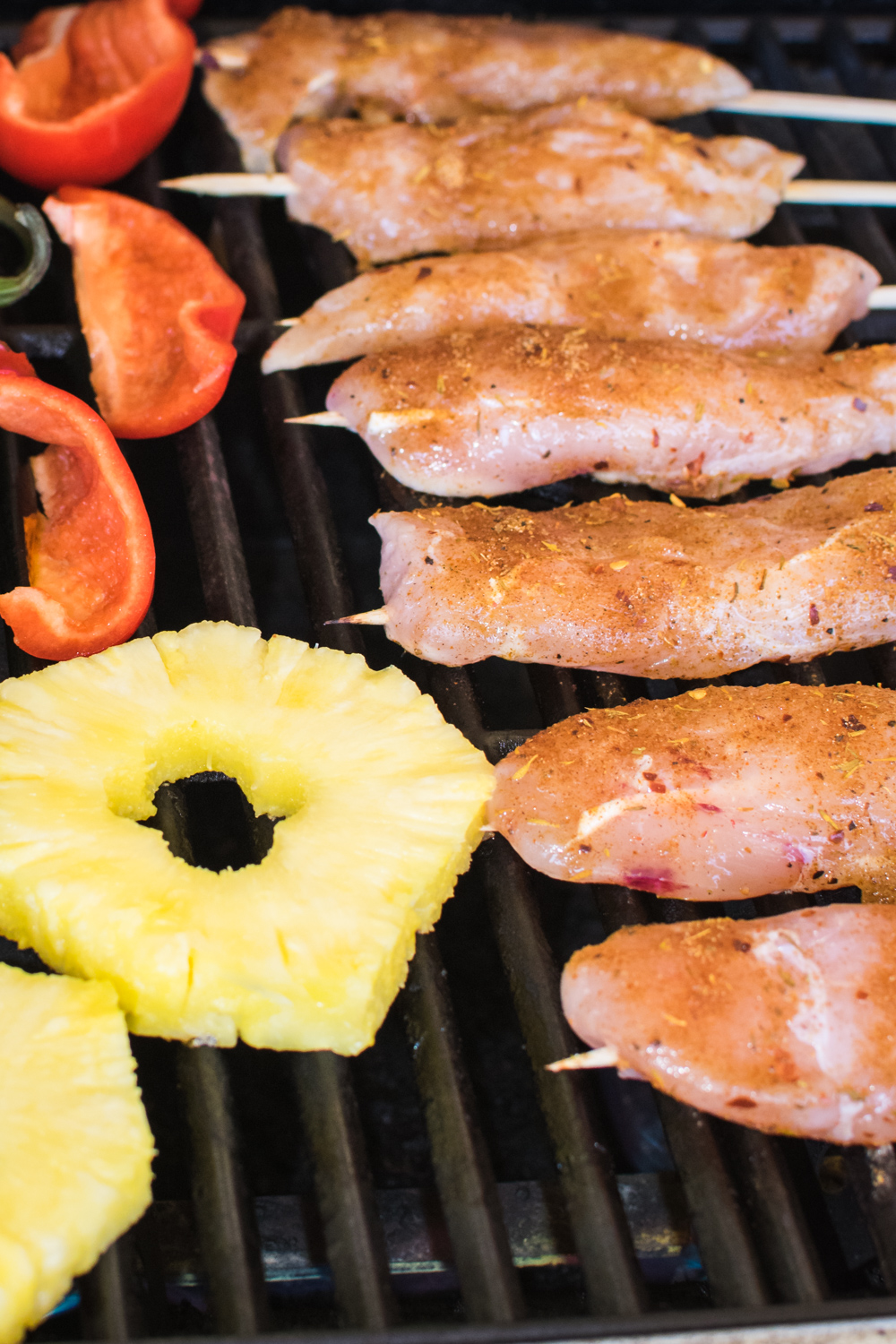 Grilling Jerk Chicken Skewers with pineapple