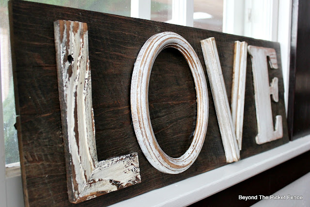farmhouse love sign made from reclaimed wood and thrift store finds