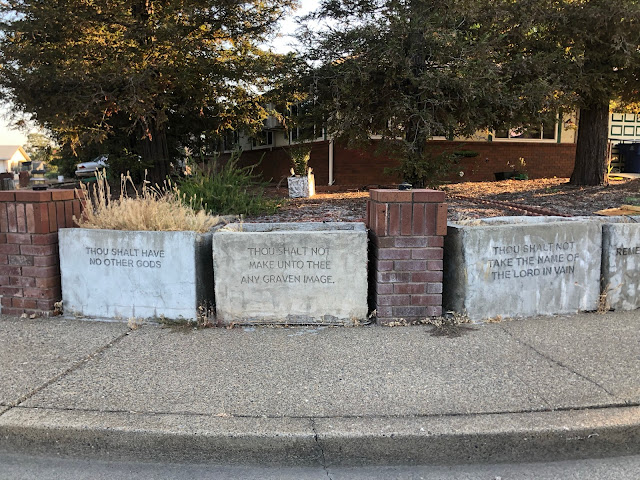 home fence made to look like stone tablets