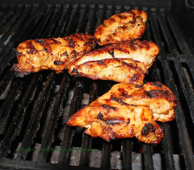 grilled chicken breasts rubbed with spices and olive oil
