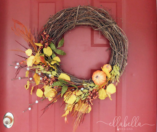 Grapevine fall wreath hanging on front door