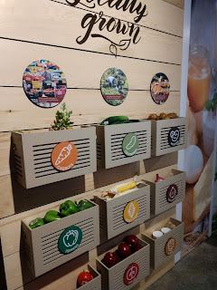 toy fruits and vegetables fill wooden crates attached to a wall in the Stockyards Ag Experience barn at Falls Park in Sioux Falls, South Dakota