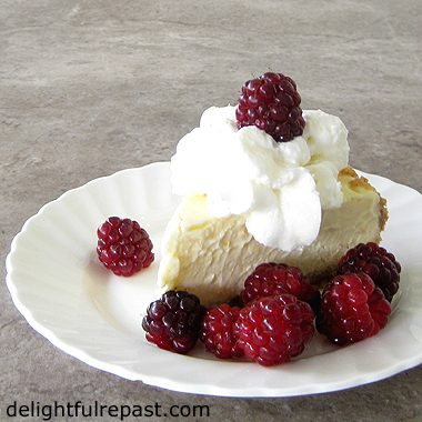 Meyer Lemon Cheesecake - or Other Lemon Cheesecake (served with fresh raspberries) / www.delightfulrepast.com