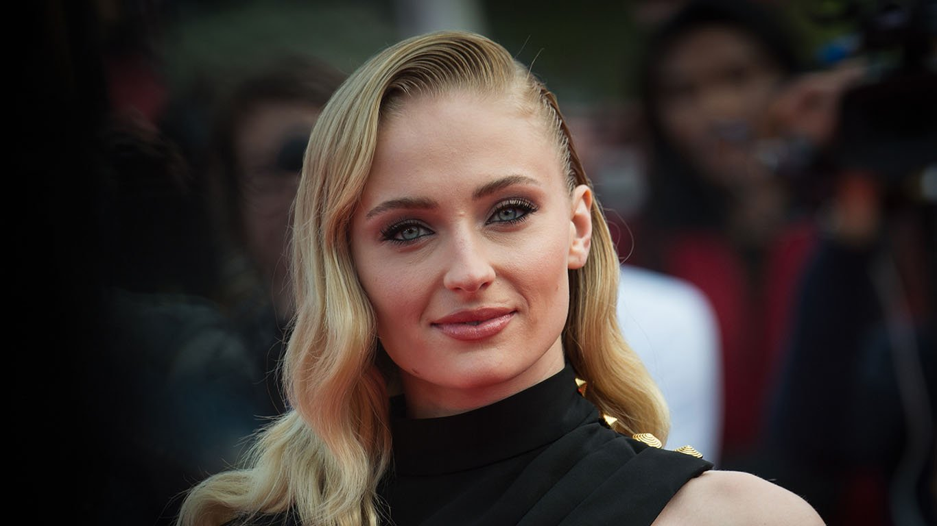 Sophie Turner looks every inch the movie star as she walks the red carpet in black off the shoulder dress at premiere of Heavy at the Deauville American Film Festival