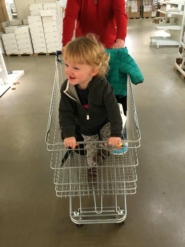 A Toddler Who Lunches. IKEA and Al Fresco.toddler standing in a shopping trolley