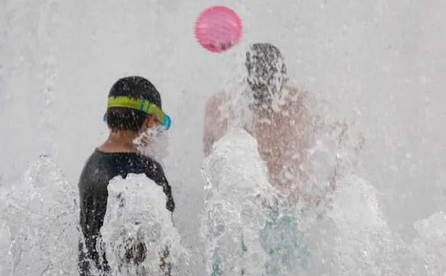 Children play in a riverside fountain during a heat wave in Portland, Oregon, on June 26. Photo: Bloomberg