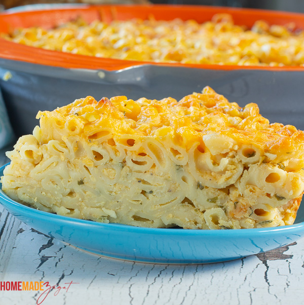 A close up of a slice of macaroni pie where you can see all the layers