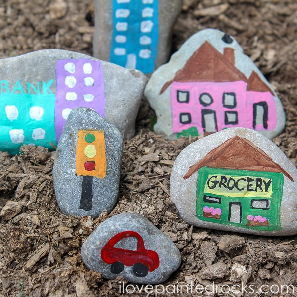 easy rock painting tutorial - how to make a town on rock - perfect for a fairy garden