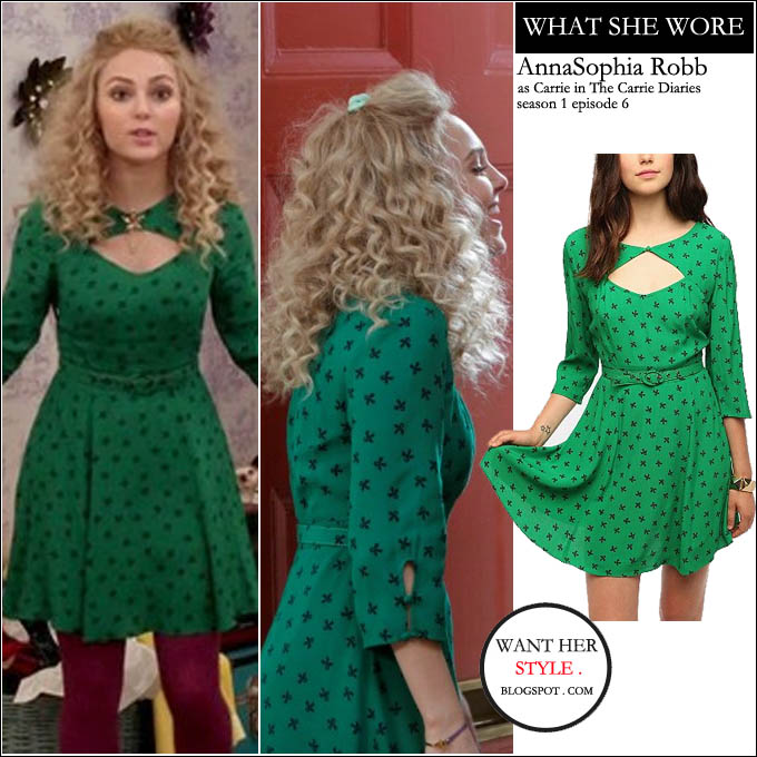 76d3c5e0465c WHAT SHE WORE: green belted dress with a cutout at the chest from  Cooperative BUY: Cooperative Crepe Sweetheart Cutout Dress