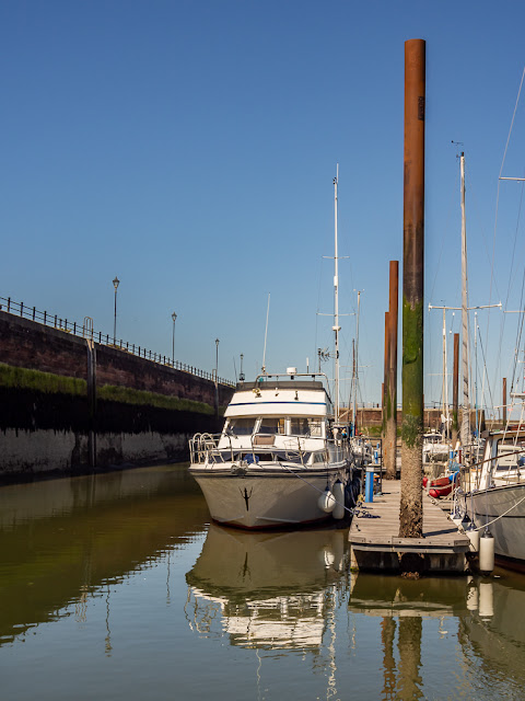 Photo of Ravensdale dwarfed by the pontoon piles at low tide