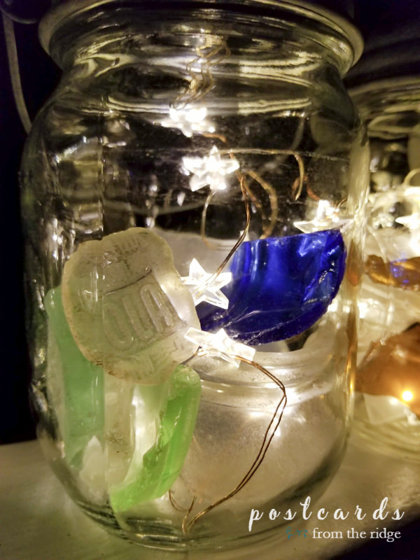mason jar lanterns with solar powered lids and sea glass
