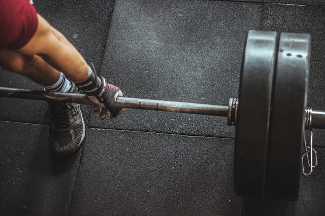 A person lifting barbell