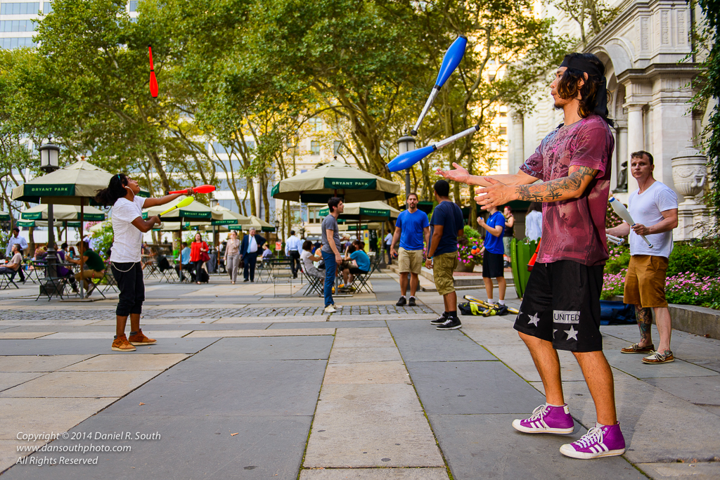 a photo of jugglers in bryant park new york